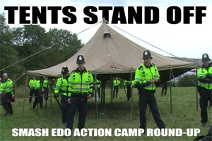 Police dismantle SchNEWS's tatty army marquee at the Smash EDO Action Camp, August 2007
